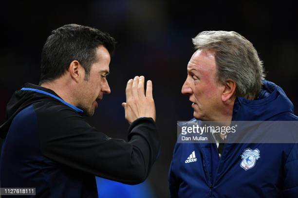Neil Warnock Manager of Cardiff City and Marco Silva Manager of Everton in discussion prior to during the Premier League match between Cardiff City...
