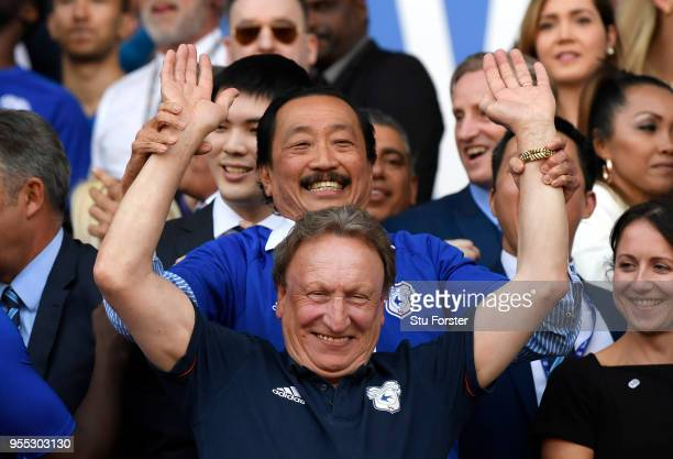 Neil Warnock Manager of Cardiff City and Vincent Tan Cardiff City owner celebrates gaining promotion to the premier league after the Sky Bet...