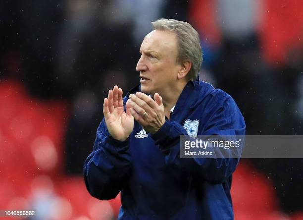 Neil Warnock Manager of Cardiff City applauds fans after the Premier League match between Tottenham Hotspur and Cardiff City at Tottenham Hotspur...