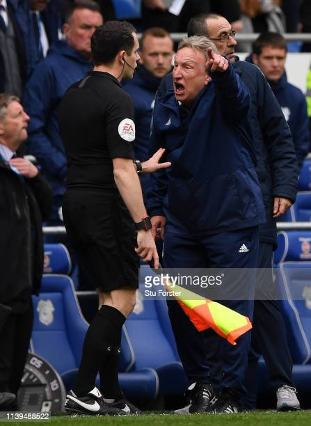 Neil Warnock Manager of Cardiff City argues with the fourth official during the Premier League match between Cardiff City and Chelsea FC at Cardiff...
