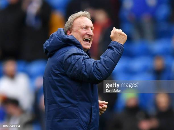 Neil Warnock Manager of Cardiff City celebrates following his sides victory in the Premier League match between Cardiff City and Brighton Hove Albion...