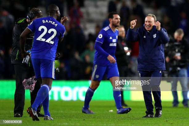 Neil Warnock Manager of Cardiff City celebrates victory with Sol Bamba during the Premier League match between Cardiff City and Wolverhampton...