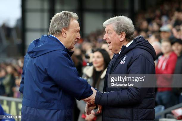 Neil Warnock Manager of Cardiff City embraces Roy Hodgson Manager of Crystal Palace prior to the Premier League match between Crystal Palace and...