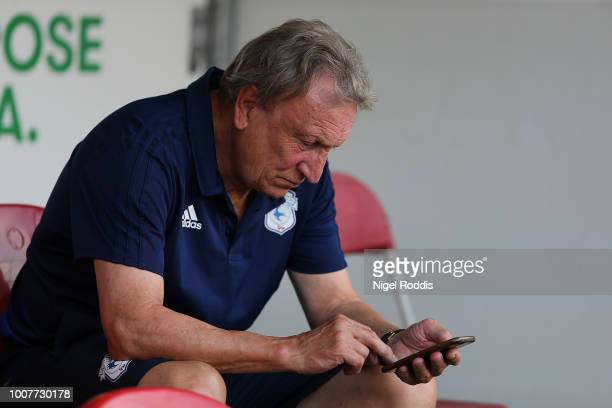 Neil Warnock manager of Cardiff City looks at his phone during the at PreSeason Friendly match between Rotherham United and Cardiff City at The New...