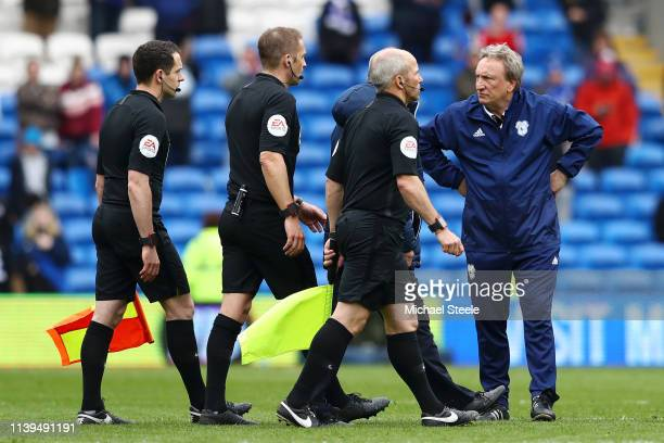 Neil Warnock Manager of Cardiff City looks at match referee Craig Pawson after the final whistle during the Premier League match between Cardiff City...