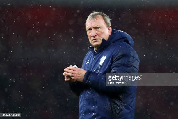 Neil Warnock Manager of Cardiff City looks dejected after the Premier League match between Arsenal and Cardiff City at Emirates Stadium on January 29...
