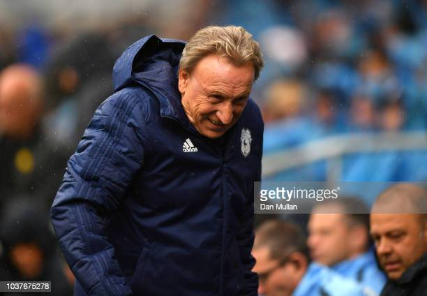 Neil Warnock Manager of Cardiff City looks on prior to the Premier League match between Cardiff City and Manchester City at Cardiff City Stadium on...