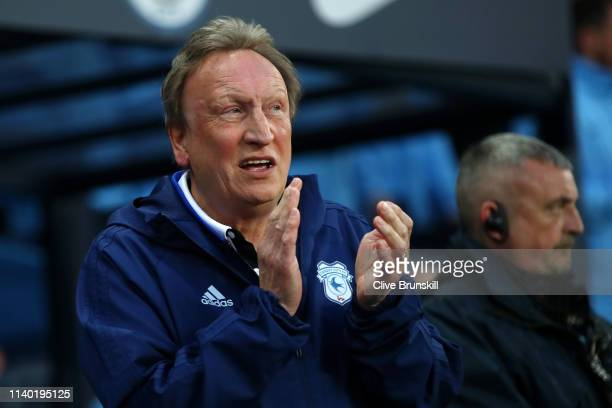 Neil Warnock Manager of Cardiff City looks on prior to the Premier League match between Manchester City and Cardiff City at Etihad Stadium on April...