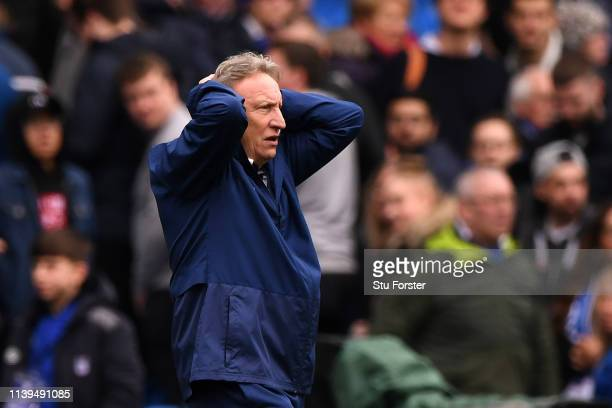 Neil Warnock Manager of Cardiff City reacts at the full time whistle after the Premier League match between Cardiff City and Chelsea FC at Cardiff...