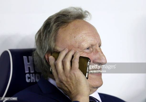Neil Warnock, Manager of Cardiff City speaks on the phone prior to the Sky Bet Championship match between Millwall FC and Cardiff City at The Den on...