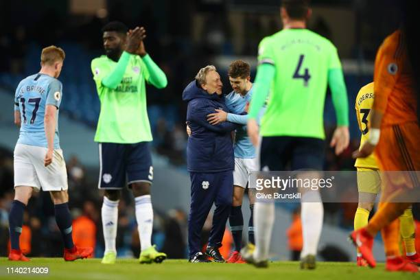 Neil Warnock Manager of Cardiff City speaks to John Stones of Manchester City after the Premier League match between Manchester City and Cardiff City...
