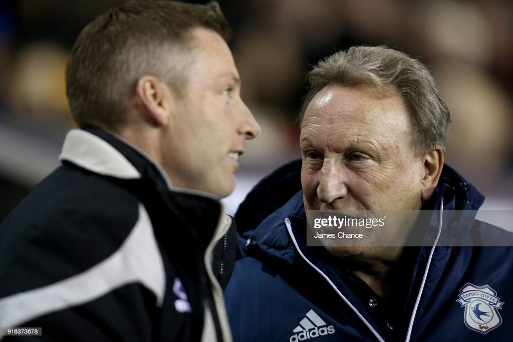Neil Warnock, Manager of Cardiff City speaks to Neil Harris, manager of Millwall prior to the Sky Bet Championship match between Millwall and Cardiff Cityat The Den on February 9, 2018 in London, England.