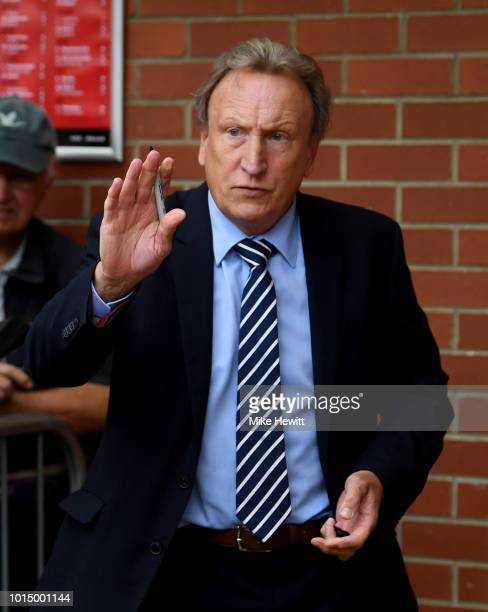 Neil Warnock Manager of Cardiff City waves to fans as he arrives prior to the Premier League match between AFC Bournemouth and Cardiff City at...