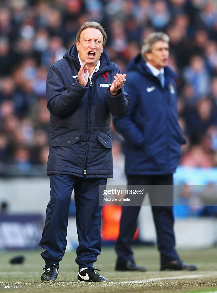 Neil Warnock, manager of Crystal Palace encourages his team with Manuel Pellegrini, manager of Manchester City during the Barclays Premier League match between Manchester City and Crystal Palace at Etihad Stadium on December 20, 2014 in Manchester, England.