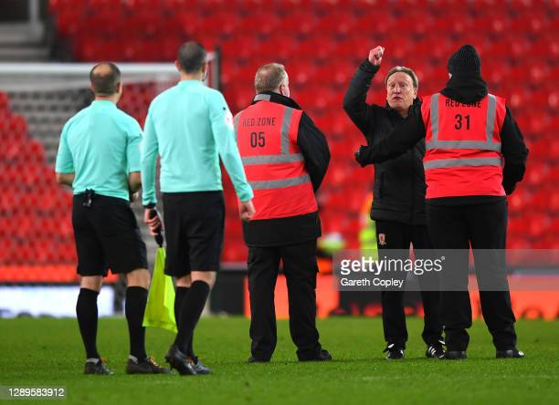 Neil Warnock, manager of Middlesborough is held back by a steward during the Sky Bet Championship match between Stoke City and Middlesbrough at...