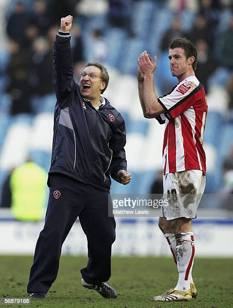 Neil Warnock manager of Sheffield United celebrates his teams win with Michael Tonge during the CocaCola Championship match between Sheffield...