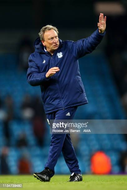 Neil Warnock the head coach / manager of Cardiff City applauds the fans at full time during the Premier League match between Manchester City and...
