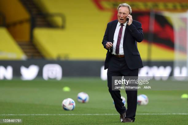 Neil Warnock the manager \ head coach of Middlesbrough on his phone before the Sky Bet Championship match between Watford and Middlesbrough at...