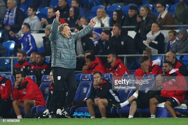 Neil Warnock the manager of Cardiff City celebrates his side's 21 victory on the final whistle during the Sky Bet Championship match between Cardiff...