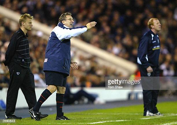 Neil Warnock the manager of Sheffield shouts instructions as Gary Megson the West Brom manager looks on during the Nationwide League Division One...