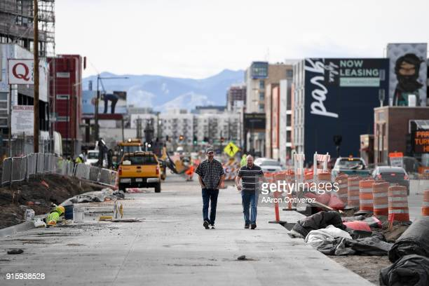 Neil Watson and Dallin Jones walk through construction due to a complete of sidewalks  a result of mass construction New constructions are aplenty in...