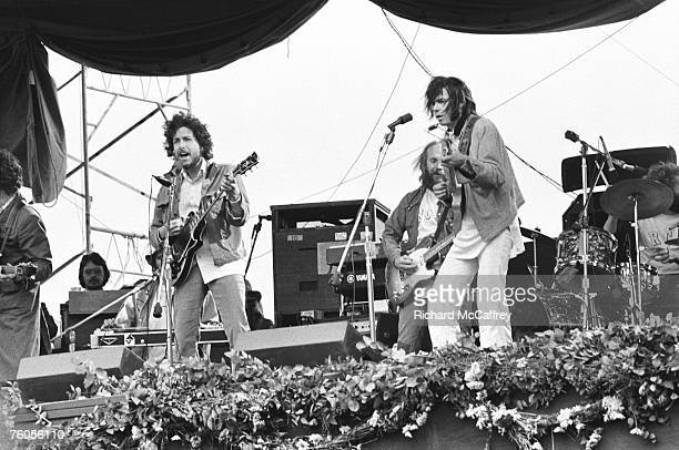 Neil Young and Bob Dylan perform at Bill Graham's SNACK Benefit at Golden Gate Park on March 23 1975 in San Francisco California