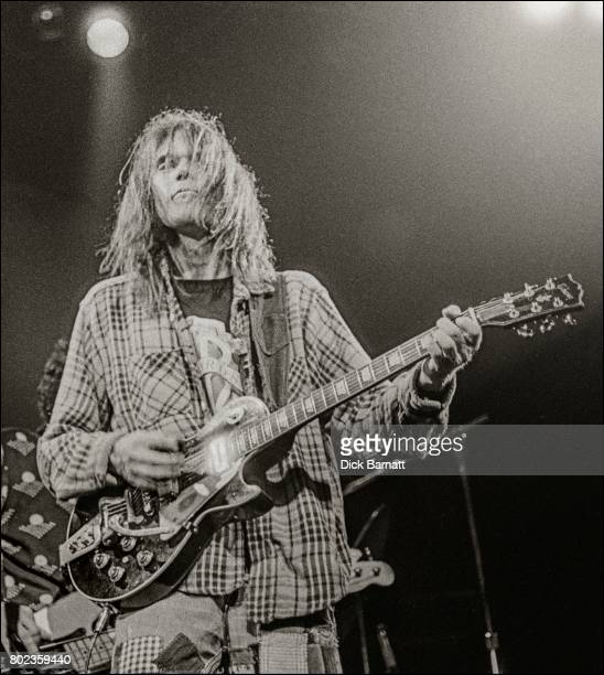 Neil Young and Crazy Horse performing on stage Hammersmith Odeon London March 28th 1976