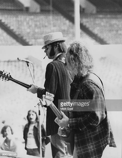 Neil Young and David Crosby of folkrock group Crosby Stills Nash Young soundchecking before a concert at Wembley Stadium London 14th September 1974