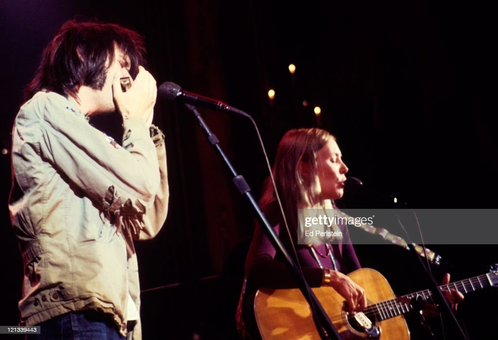 Neil Young and Joni Mitchell perform with The Band during The Last Waltz at Winterland in November 1976 in San Francisco, California.
