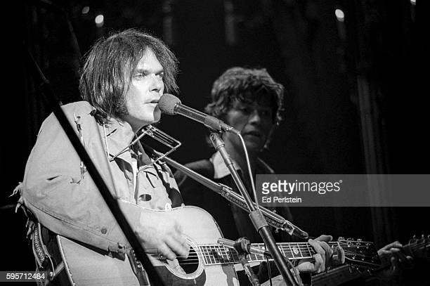Neil Young and Robbie Robertson of The Band perform during The Last Waltz at Winterland on November 25 1976 in San Francisco California