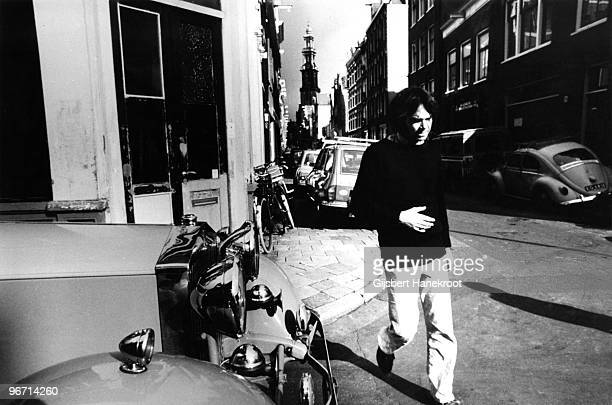 Neil Young checks over The Rolls Royce car he has just purchased in Jordaan, Amsterdam, Netherlands in 1974