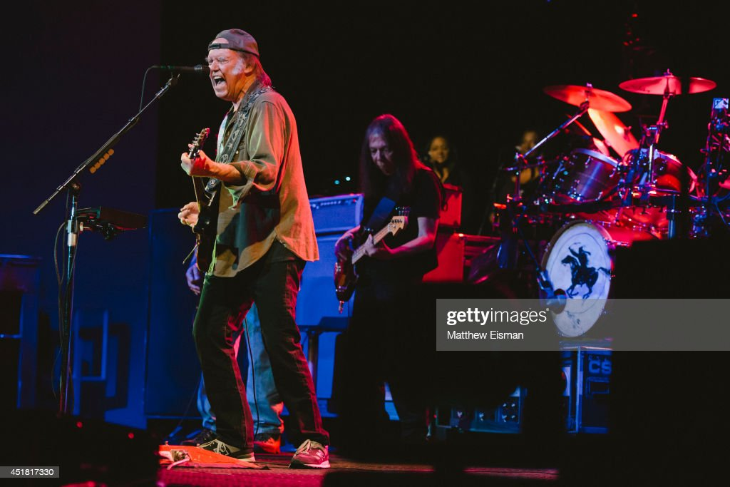 Neil Young & Crazy Horse performs live on stage for ATP Iceland Festival 2014 at Laugardalshollin on July 7, 2014 in Reykjavik, Iceland.