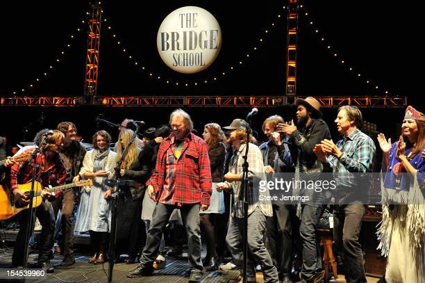 Neil Young, Eddie Vedder, Gary Clark Jr. And John Doe sing at the finale at the 26th Annual Bridge School Benefit at Shoreline Amphitheatre on...