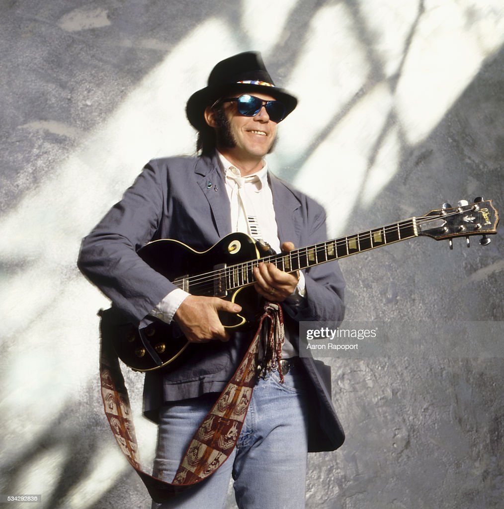 Neil Young holding electric guitar