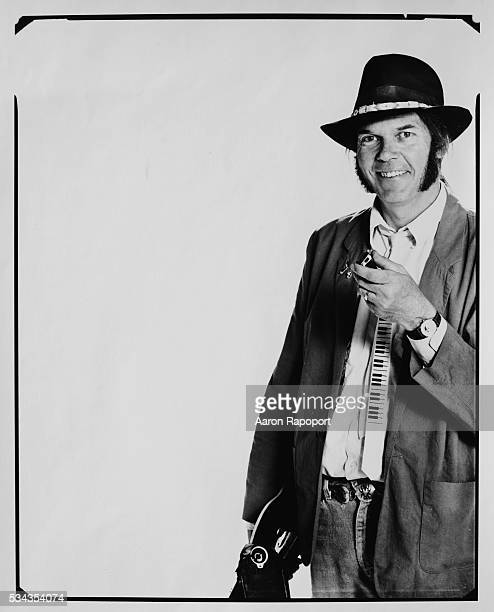 Neil Young Holding Harmonica