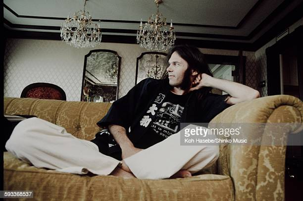 Neil Young in happicoat relaxing at a hotel Tokyo March 1976