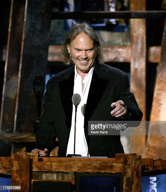 Neil Young introduces Mo Ostin during The 18th Annual Rock and Roll Hall of Fame Induction Ceremony Show at The Waldorf Astoria in New York City New...