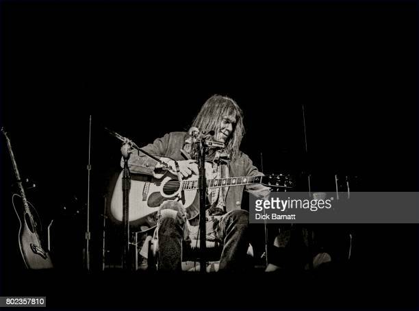 Neil Young performing on stage Hammersmith Odeon London 29th March 1976