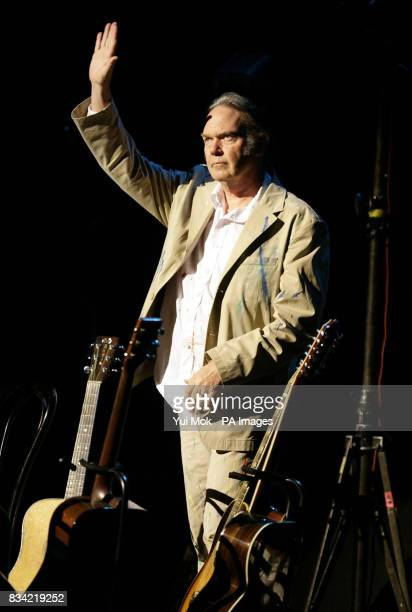 Neil Young performing the acoustic half of his concert at the Hammersmith Apollo in west London