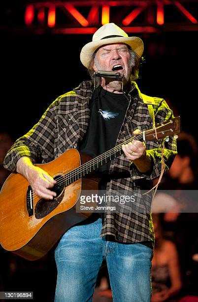 Neil Young performs at the 25th Annual Bridge School Benefit Concert at Shoreline Amphitheatre on October 23 2011 in Mountain View California