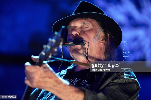 Neil Young performs during a concert at Farm Aid 2017 on September 16 2017 at Keybank Pavilion in Hanover Township PA
