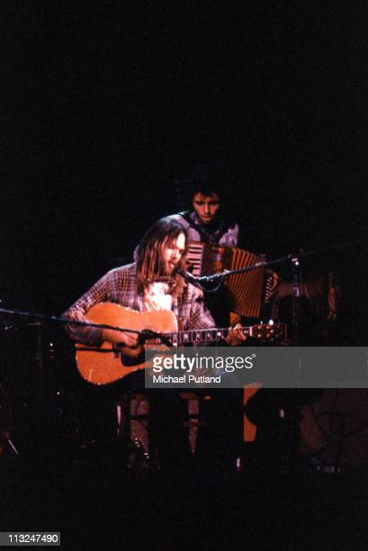 Neil Young performs on stage at Hammersmith Odeon London 28th March 1976