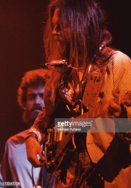 Neil Young performs on stage at the Rainbow Theatre with The Santa Monica Flyers Billy Talbot behind London 5th November 1973