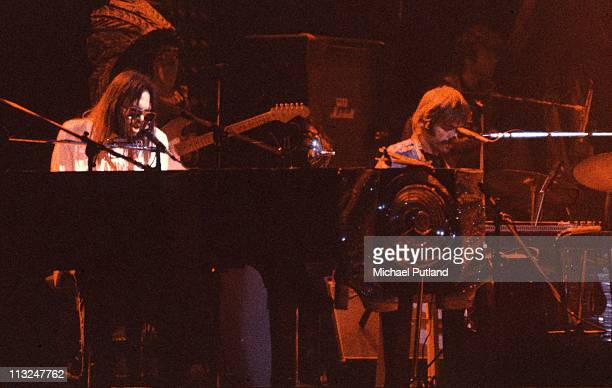 Neil Young performs on stage at the Rainbow Theatre with The Santa Monica Flyers Ben Keith on right London 5th November 1973
