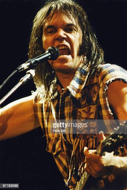 Neil Young performs on stage at Wembley Arena on June 3rd 1987 in London England