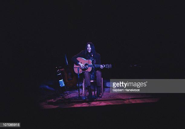 Neil Young performs on stage in 1971 in London