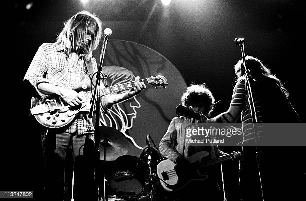 Neil Young performs on stage with Crazy Horse at Hammersmith Odeon London 28th March 1976 LR Neil Young Billy Talbot Frank Sampedro Young plays a...