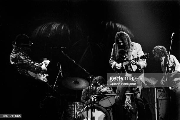 Neil Young performs on stage with The Santa Monica Flyers on Tonight's The Night, Rainbow Theatre, London, United Kingdom, 5th November 1973. L-R...