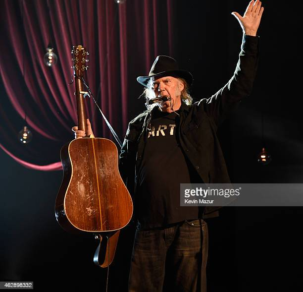 Neil Young performs onstage at the 25th anniversary MusiCares 2015 Person Of The Year Gala honoring Bob Dylan at the Los Angeles Convention Center on...