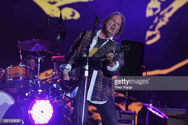 Neil Young performs onstage at the Global Citizen Festival In Central Park to end extreme poverty Show at Central Park on September 29 2012 in New...